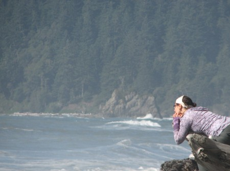 A Young Woman Enjoying the Beauty at Rialto Beach
