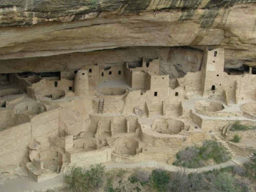 A portion of the Cliff Palace complex, showing several kivas in the front and a four story tower on the right side