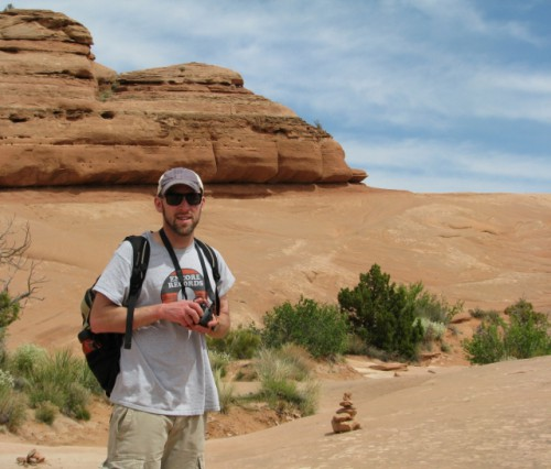 Jon posed on the hike to Delicate Arch. You can see a cairn behind him.