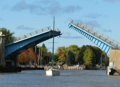 A sailboat going under the drawbridge in Manistee, Michigan