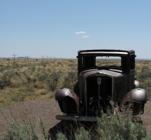This car didn't make it to California! The telephone poles in the background mark the old Route 66.
