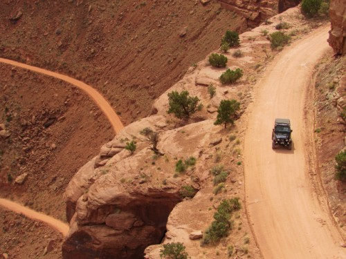 A Jeep headed down the Schafer Rim Trail into Schafer Canyon