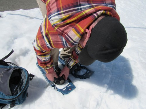 Jon straps on his snowshoes.