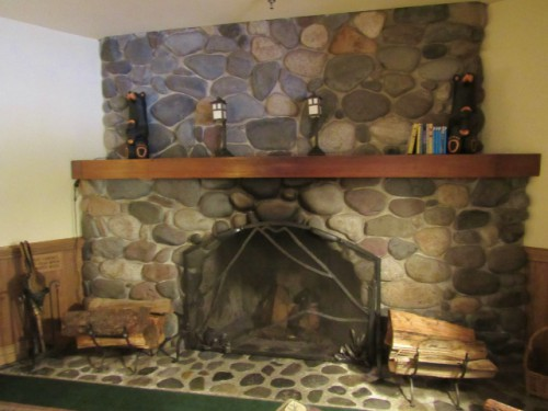 The fireplace in the game room at the National Park Inn