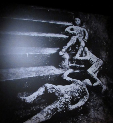 A photo of the actual excavation in Pompeii, showing the image of three people who died.