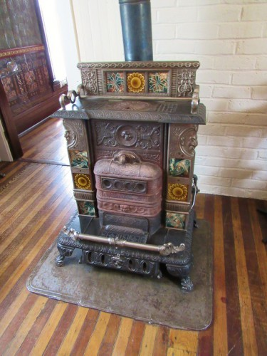 The stove, with inlaid Italian tile