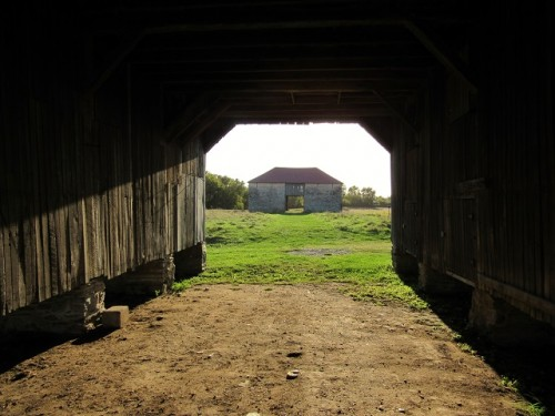A photo of the Best barn, through another Best barn.