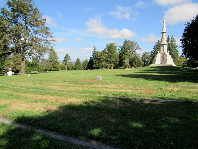 A view of the Soldier's Monument, with Civil War graves in the foreground.