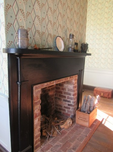 The fireplace at Ellwood, with some Civil War artifacts