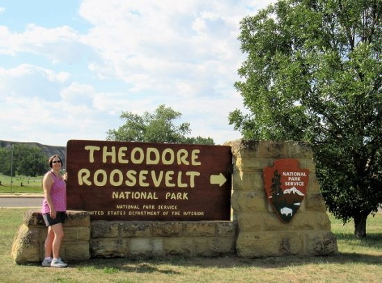 The West Entrance to the South Unit of Theodore Roosevelt National Park in Medora, North Dakota. And me!