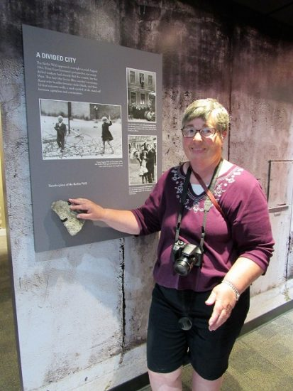 Mom, with a piece of the Berlin Wall