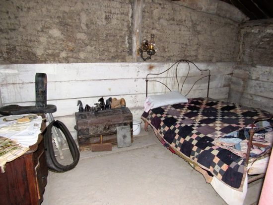 The bedroom in the sod house, showing the sod walls.