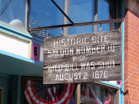 A sign marking the saloon where Wild Bill Hickok was shot