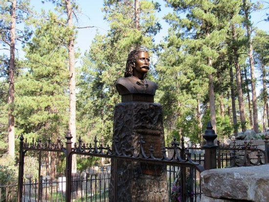 Wild Bill Hickok's grave in Mount Moriah Cemetery, overlooking town