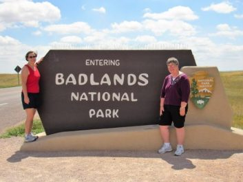 Mom and me with the Badlands Sign! Can you tell by my hair that it was windy?