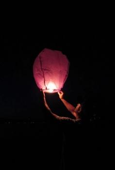 Brandon releasing a paper lantern