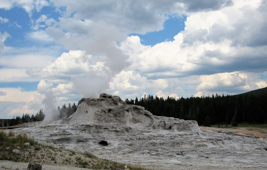 Castle Geyser with Grand Geyser erupting behind it