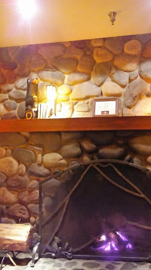 The fireplace in the game room