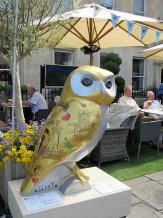 A golden cocktail owl