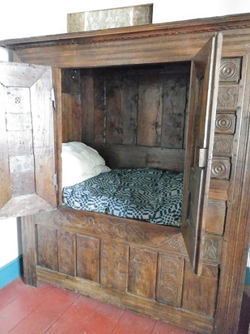 An antique box bed