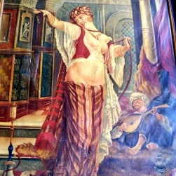 The painting on the wall of the Bird Cage Theatre